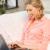 woman with laptop typing  at home