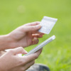 Close-up woman's hands holding a credit card and using cell phon